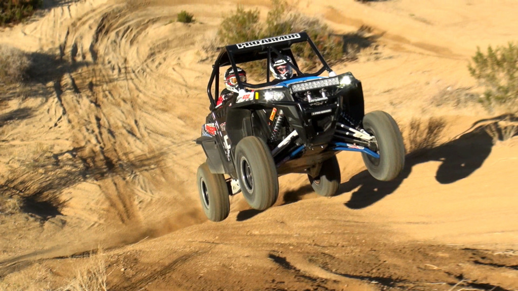 polaris_xp_900_ct_racing_adventure_car_action_uphill_jump